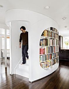 Love this staircase and bookcase!