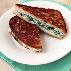 I fiddled with this recipe a bit. I subbed Neufchâtel for cream cheese and Gouda for fontina. I used two cloves of garlic and doubled the salt, so I could use the whole block of Neufchâtel and can of artichoke hearts. I stirred half of the shredded Gouda into the spinach dip part. The sandwich to filling ratio was a bit tricky, but it is delish once you get it. Pepperidge Farm sourdough bread.