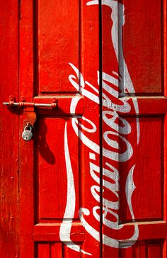 A padlocked door with the Coca Cola trademark. So what is behind the door you know it has to be Coca Cola. Coca Cola Vintage, Always Coca Cola, Vintage Design, Shades Of Red, Pepsi, Arches, Red And White, Palette, Windows
