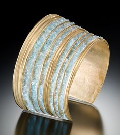 "Lisa Cimino's ""Stone Cuff"" is lathe-turned silver with an 18kt-gold vermeil and crushed aquamarine gemstones"