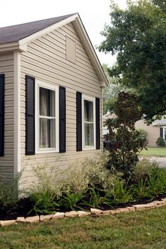 Fixer Upper hosts Chip and Joanna Gaines repainted the siding a neutral shade and the shutters black for a fresh updated to the exterior. They also updated the landscaping and added new grass.