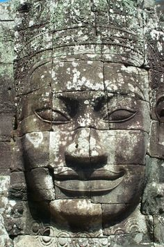 Close up of a smiling Buddha and/or Jayavarman VII face in the Bayon temple at Angkor Thom. this is the photo reference for the Buddha face tattoo