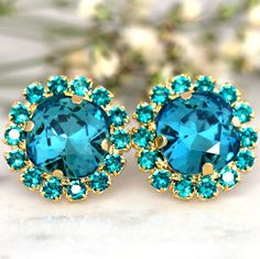 Teal Blue Earrings,Swarovski Dark Teal Earrings,Blue Zircon Bridal Stud Earrings,Gift for her,Bridesmaids Earrings,Indicolite Earrings One Of our best sellers- Elegant earrings with Blue Teal -colored crystal rhinestones and Blue Teal petite stones ♥ 18 mm in diameter ♥ Available in Gold Finish ♥ 1 year guarantee ♥ Wrapped and ready to give, arrives in our signature Petite Delights by Ilona Rubin® Box. ♥ U.S packages insured & shipped with USPS® tracking number ♥ hand set in secure prong...