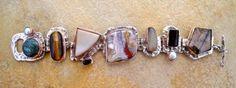 BS12 - 11   Bracelet Silver with Copper Bezels w/ azurite/chrysachola, tigers eye, drusé, garnet, laguna agate, moonstone, black tourmaline, andalucite & pearls