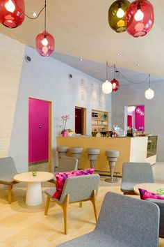 """As you can see from the bright accents of powder blue and Barbie pink, the interior is meant to elicit a strong response. According to Note, owner Michael Toutoungi said that he wanted a space that """"people either love or hate and that nobody is indifferen"""