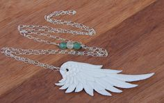 http://bahgsujewels.com/collections/earth-gypsy-necklaces/products/carved-angel-wing-necklace