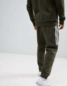 purchase cheap 0d079 e89e6 adidas Originals Outline Jersey Sweatpants In Green DH5792