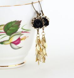 Black and Gold Dangle Earrings With Golden Leaves by JacarandaDesigns, $22.00