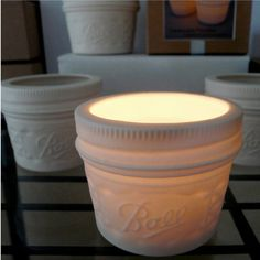 Porcelain Mason Jar Votive Candle Holder....The more I think about it, the more appealing slip-casting sounds to me.