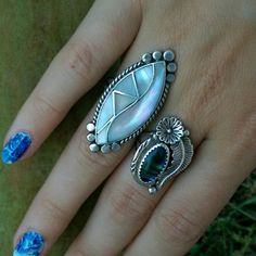Vintage Mother of Pearl Ring Pictures don't do this Mother of Pearl justice! Flashy and full of color, it's hard parting with this beauty! The craftsmanship is superb. Stamped and tested sterling. Jewelry Rings