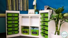 One white Kallax Shelf and two Trofast Frames with green storage boxes. For the classroom or kid toy storage one day