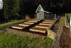 Ten new raised beds replace a weedy in-ground garden area at client Andrea's rural home.