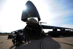 U.S. Air Force Airmen with the 709th Airlift Control Squadron and the 442d Maintenance Squadron load cargo onto a C-5 Galaxy aircraft at Whiteman Air Force Base Mo., Jan. 25, 2016. The total force integration between the units, along with the 509th Logistics Readiness Squadron, enabled equipment to be transported to Patrick AFB, Fla., in support of a multi-week combat, search and rescue exercise. (U.S. Air Force photo by Senior Airman Keenan Berry)