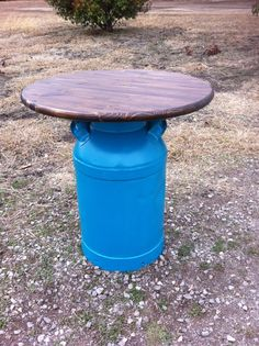 Old milk can table. Would look good with my shutters & rockers painted the same blue.