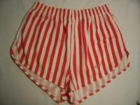 Dolphin shorts, you know, they were all silky and stuff.  I'm embarassed to admit that I had at least 2 pairs of these... baby blue & white stripes as I recall.  Eek!