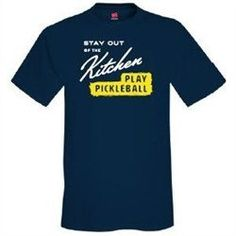 """The Men's Kitchen Shirt is causal, comfortable and the kind of shirt that should be found in every pickleball player's closet. This 100% cotton shirt pokes fun at the use of the word """"kitchen"""" to desc"""