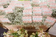 Select bright escort cards that match your color palette. Guests will be drawn to the colorful display, which you can dress up with additional flowers for a bold look.