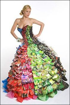 Dress made with cans, bottle tops and cardboard boxes by Gary Harvey