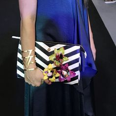 We love stripes!!! Leather clutch with Colombian Orchids 🌸🌸🌸 by Alejandra Valdivieso - jewelry designer.