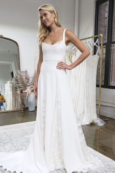 The Sienne Gown might just be our favorite gown this season. This romantic, silk crepe A-line style is perfectly balanced by hand-embroidered floral appliqué panels in the skirt. Our modern, wide scoop neckline is softened by floral petals peeking out from the neck and backline to create a gown with both clean lines and feminine details.  Available in Off White. Unique Wedding Gowns, Casual Wedding, Wedding Dresses, Wedding Details, Contemporary Dresses, Spaghetti Strap Dresses, Wedding Looks, Party Fashion, Silk Crepe