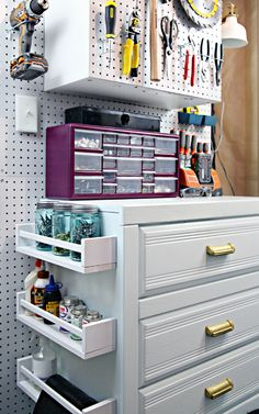 IHeart Organizing: Our Storage Room is FINALLY Organized! Small tools and household items stored in the drawers using dividers and shoe boxes to separate. IKEA spice drawers on dresser side for narrow cans. Pegboard above for more tools.