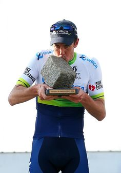 37 yr. old Matt Hayman (Orica-GreenEdge) kisses the Paris-Roubaix trophy.  He's been riding professionally 17 years.