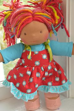 This is Classic Bamboletta Joy from the December 14, 2012 upload. She has dark tan skin, brown eyes, and crayola red hair (dreads/mohair/wool) with rainbow streaks/dreads.