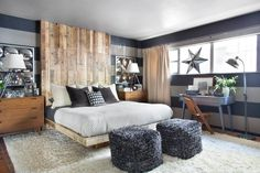 Though there are no especially bold colors used in this neutral master bedroom, the use of textures and stripes bring this small space to life. An oversized bedroom made of reclaimed wood set in a perpendicular pattern to the wall stripes add extra drama and a dose of warmth.
