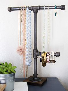 If you're one who can't say no to pretty jewelry, then you need a creative way to show off your best pieces when they're not being worn. These simple DIY jewelry organizers give your baubles a pretty and practical place to la