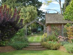 Victorian Arch and gate, separating two areas of garden, elegant and unobtrusive.