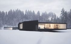 An award-winning American architect William O'Brien Jr. has recently completed these two single-storey holiday houses located in upstate New York. Situated on one plot of land, the minimalist, black stucco-clad dwellings have been realised as 'a regular six-sided polygon and a regular four-sided polygon' respectively yet are composed from the same five forms — 'each are made up of the same four trapezoids and one triangle.