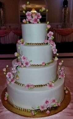 Calumet Bakery Cherry Blossom Wedding Cake Calumet Bakery, Cherry Blossom Wedding, Floral Arrangements, Wedding Cakes, Desserts, Food, Wedding Gown Cakes, Tailgate Desserts, Deserts