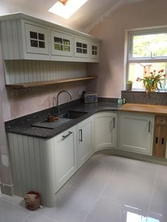 Bamburgh painted Lime White w/ 30mm silestone worktops in Mountain Mist and 40mm Rustic Oak