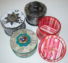 Trinket boxes made from empty tape rolls, wooden coasters, can lids, recycled jewellery