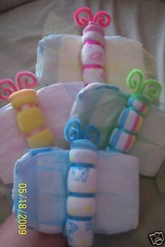 Diaper butterflies, made with diapers, ribbon and pipe cleaners