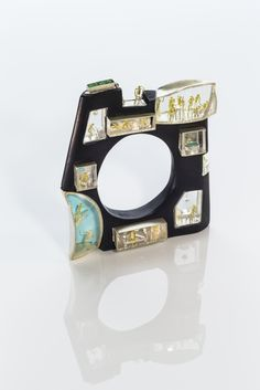 """Home, sweet home"" by Asagi Maeda, painted maple wood, sterling silver, 18K gold, uvarovite garnet, acrylic"