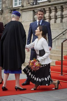 Crown Princess Mary was all smiles as she greeted Queen Margrethe with a curtsy...