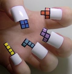 tetris nails - good start, but not how I would go. Black nails with shapes on the bed would be much easier to work with in real life.  Although, strictly for photography or a fashion show . . . this would work. I'd still go black instead of white nails though
