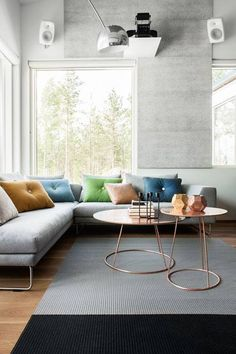 Home Decor - love the back pallet of grey, with pops of colour, and the copper coffee tables!