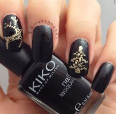 Black nails with gold reindeer & Christmas tree