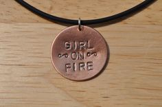 Girl on Fire copper hand stamped pendant by Charmed Identities