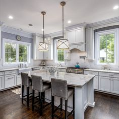 Chef's kitchen with center island, quartz counter top, high-end Thermador appliances, pot filler, custom stand mixer cabinet, walk-in pantry, butler's pantry with wine fridge and a breakfast room.  Listed in Vienna, Virginia for $1.6M by The Casey Samson Team is a Wall Street Journal Top Team in Northern Virginia