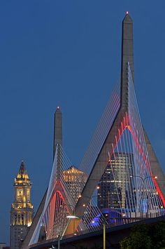 Boston skyline photography from New England and Boston based fine art photographer Juergen Roth showing landmarks such as the Custom House of Boston, Leonard P. Zakim Bunker Hill Memorial Bridge, One International Place and the TD Bank North Garden home to the Boston Bruins and Celtics captured on a twilight night in September 2013. www.RothGalleries.com