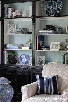 Melinda's living room shelves styled with B, silver and white objects.