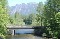The two icons of the Snoqualmie Valley, 4167-foot Mount Si and the south fork of the Snoqualmie River, were observed from a Northwest Railway Museum train west of North Bend, Washington on 26-June-2010