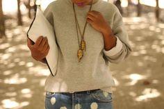 Sweatshirt, brass beetles & color-blocked black/white clutch via StyleLust Pages: NYFW: Look #4
