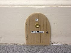 Mr Mouse door in skirting board seen at dentist in Forres, Scotland  I added a mouse door to the base board, not this one though.
