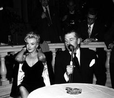 """Marilyn and Laurence Olivier at a press conference for """"The Prince and The Showgirl at the Plaza Hotel, New York. Photo by Milton Greene, February 9th 1956."""