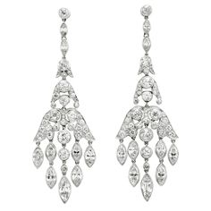 A pair of Art Deco diamond earrings, designed as a circular and marquise cut diamond flexible chandelier, mounted in platinum. Art Deco Earrings, Art Deco Jewelry, Chandelier Earrings, Dangle Earrings, Diamond Earrings, Fine Jewelry, Platinum Earrings, Art Projects For Adults, Antique Jewelry