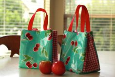 oil cloth lunch bags - so cute! (includes link to the tutorial)